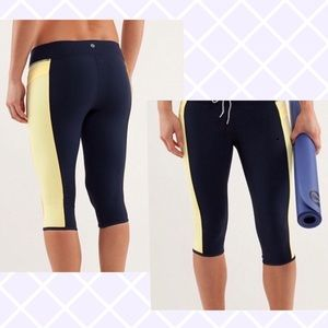 Lululemon Heat it Up crop navy yellow leggings